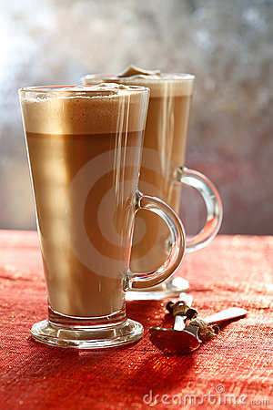 Coffee Latte on glitter backdrop with sunny light