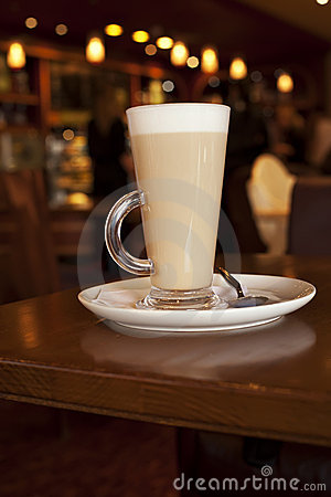 Latte coffee in tall glasse on a cafe table