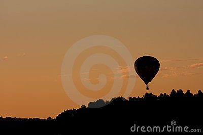 Flying baloon at sunset