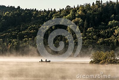 Canada Ontario Lake of two rivers Canoe Canoes foggy water sunrise fog golden hour on water in Algonquin National Park