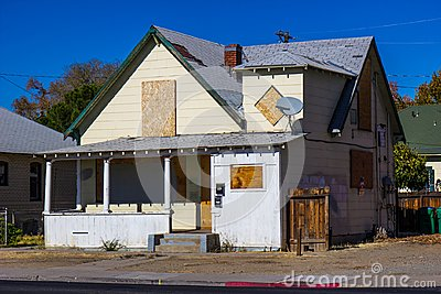 Old Boarded Up Home Lost To Foreclosure