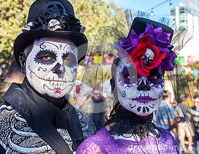 SAN ANTONIO, TEXAS - OCTOBER 28, 2017 - Couple wears face paint and hats decorated with flowers and skulls for Dia de los Muertos/