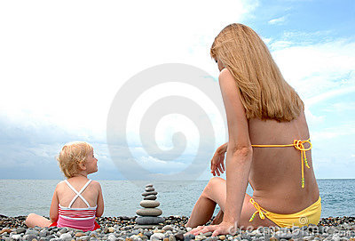 Woman and small child sit
