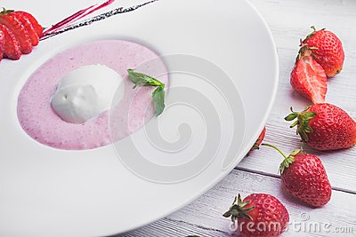 Strawberry with ice cream and mint