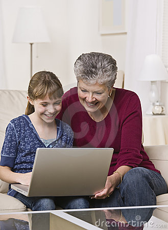 Grandma and Girl With Laptop