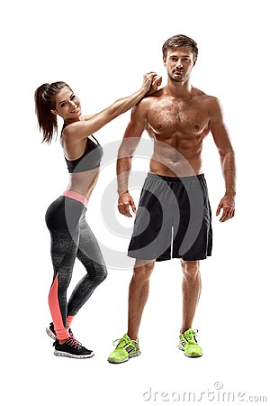 stock image of sport, fitness, workout concept. fit couple, strong muscular man and slim woman posing on a white background