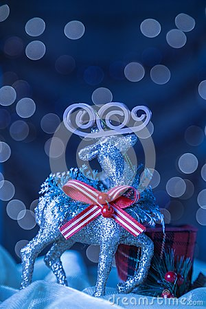 Snowy Blue Vertical Reindeer Ornament Christmas Bokeh Background