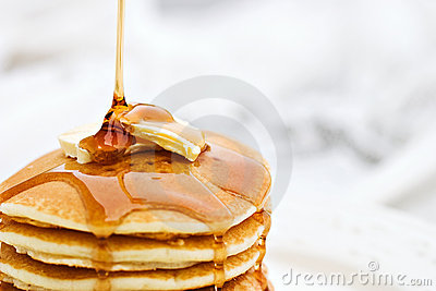 Syrup Pouring onto a Stack of Pancakes