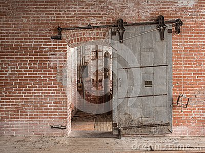 Heavy sliding metal industrial door in old warehouse