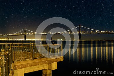 Oakland Bay Bridge by the Pier in San Francisco CA at Night