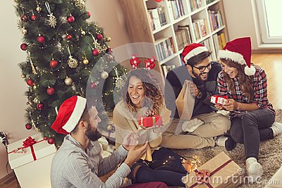 Group of friends exchanging Christmas presents