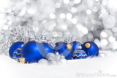 Arrangement of blue Christmas ornaments on twinkle lights