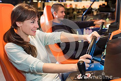 Young people at wheel arcade games
