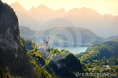 Famous Neuschwanstein Castle, fairy-tale palace on a rugged hill above the village of Hohenschwangau near Fussen