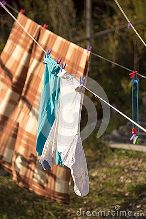 Linen dries on a rope in the open air