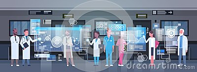 stock image of group of medical doctors using digital monitor working in hospital medicine and modern technology concept