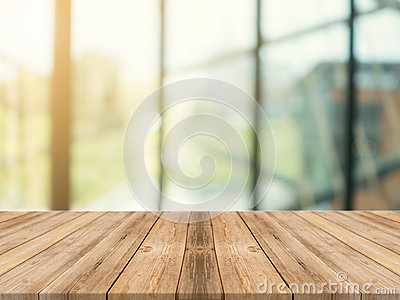 Wooden board empty table top on of blurred background. Perspective brown wood table over blur in coffee shop background.