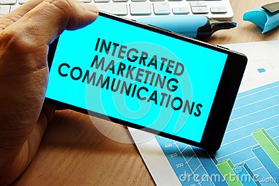 Hand holding smartphone with words integrated marketing communications.