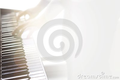 Blurry abstract music background. Playing piano.