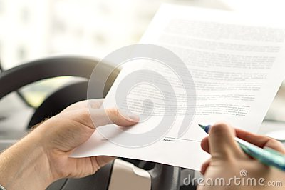 Signing lease or buying new or used car.