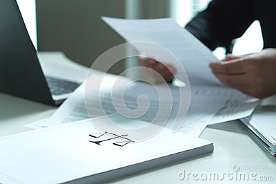 Man holding a legal document in hand.
