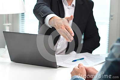 Business man offer and give hand for handshake in office.