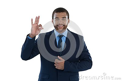 Businessman gesturing okay hand sign