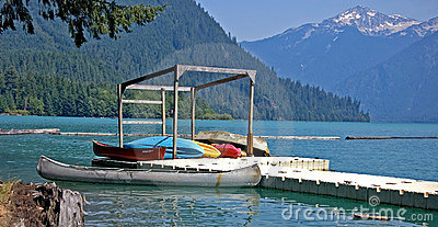 Colorful Canoes on Dock of Mountain Lake