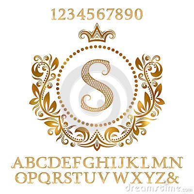 Golden patterned letters and numbers with initial monogram in coat of arms form. Shining font and elements kit for logo design