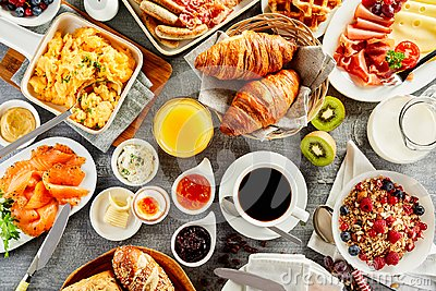 Large selection of breakfast food on a table