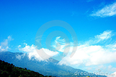 A bright blue sky over the peak