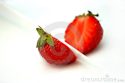Deliciously red strawberries cut into half