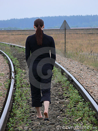 A woman walking on the railwaytrack