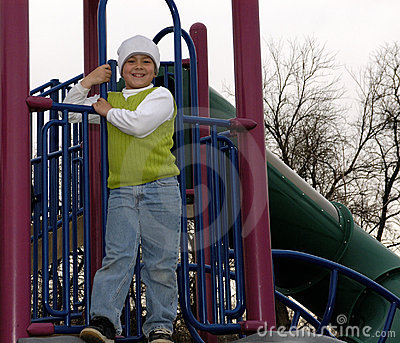 Boy at park with white sock hat