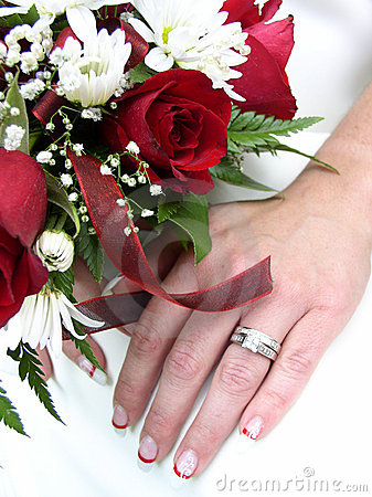 Bridal bouquet and ringed hand