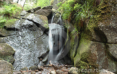 Waterfall and a moss-grown stone