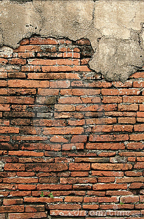 Old crumbling brick wall vertical background