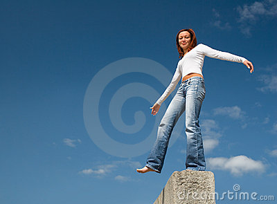 Girl balancing above a precipice-1