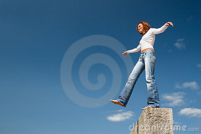 Girl balancing above a precipice-3