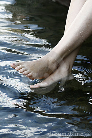 Naked feets in water