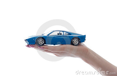 Car toy on palm