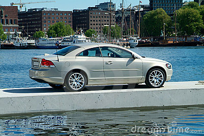 Car parked on a floating pier