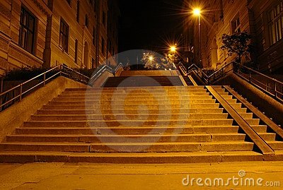 Stairway in the light of street lamps