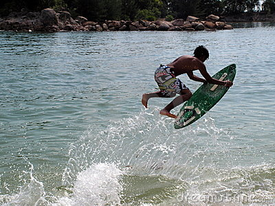 Wave skim board surfing