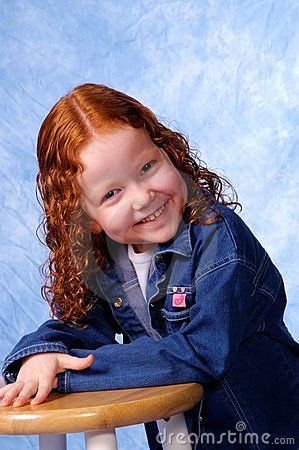 Redheaded girl smiling