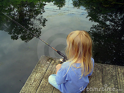 Little Girl Fishing From a Dock