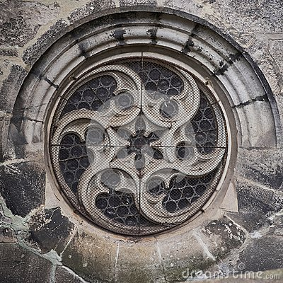 Old gothic cathedral round window.