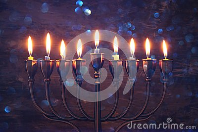 jewish holiday Hanukkah background with menorah & x28;traditional candelabra& x29; and burning candles