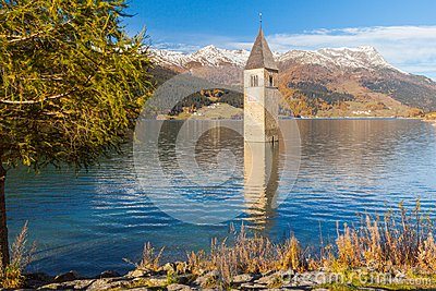 Submerged bell tower in lake resia Italian alps
