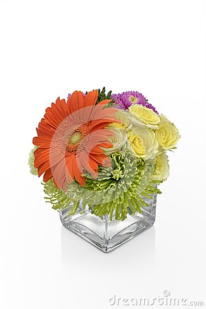 Gerbera Daisy flower arrangement in a vase with yellow Roses. Floral vase arrangement by a florist.
